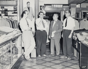 Howard Miller (left) with family members in the men's casual pants department, believed to have been taken in the 1950s.