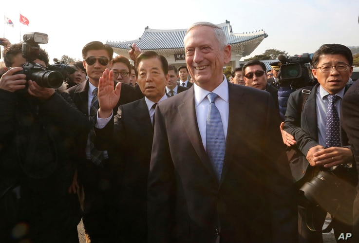 U.S. Defense Secretary Jim Mattis, center right, walks with South Korean Defense Minister Han Min Koo, center left, to meet Korean War veterans at the National Cemetery in Seoul, South Korea, Feb. 3, 2017.