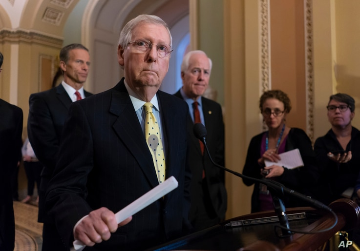 Senate Majority Leader Mitch McConnell, R-Ky., joined from left by Sen. John Thune, R-S.D., and Majority Whip John Cornyn, R-Texas, speaks to reporters on Capitol Hill in Washington, April 17, 2018.