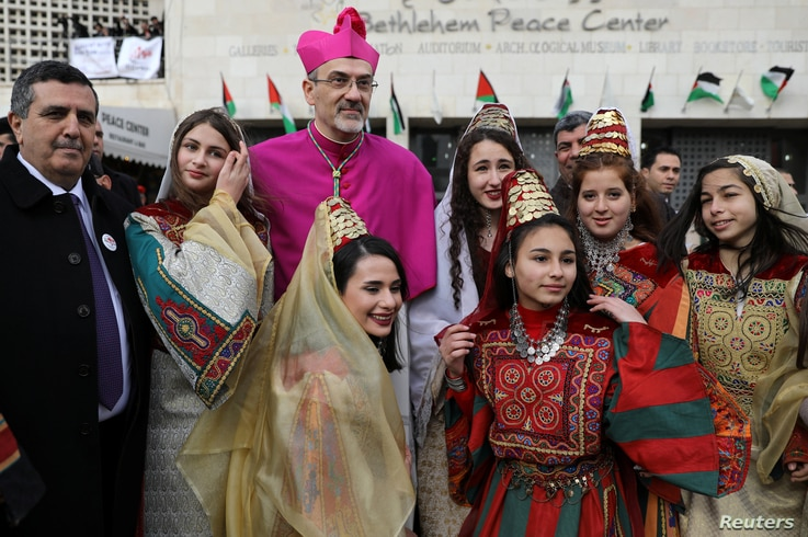 The Latin Patriarch of Jerusalem Pierbattista Pizzaballa poses for a photo during Christmas celebrations, in the West Bank city of Bethlehem, Dec. 24, 2017.