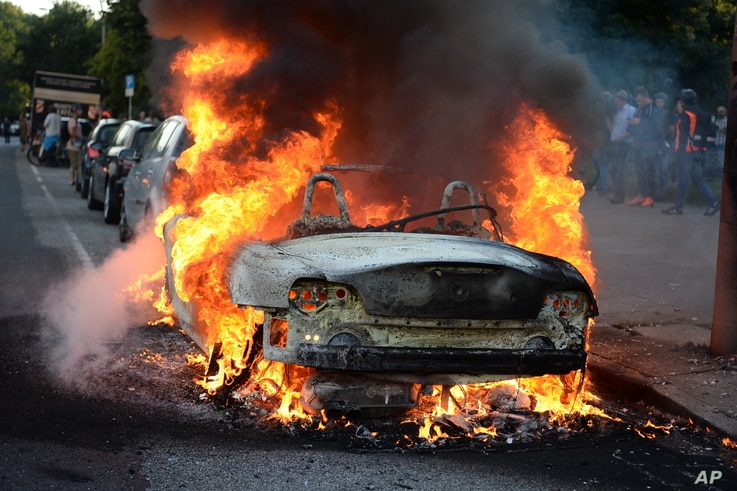 A car burns during a protest against the upcoming G-20 summit in Hamburg, Germany, July 6, 2017.