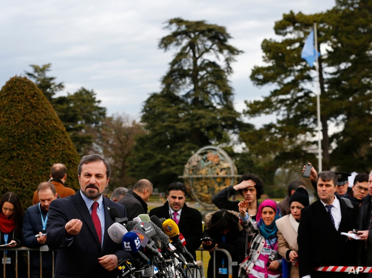 Louay Safi, spokesperson for the Syrian National Coalition, addresses media after meeting at Geneva Conference on Syria, UN European headquarters, Geneva, Feb. 15, 2014.