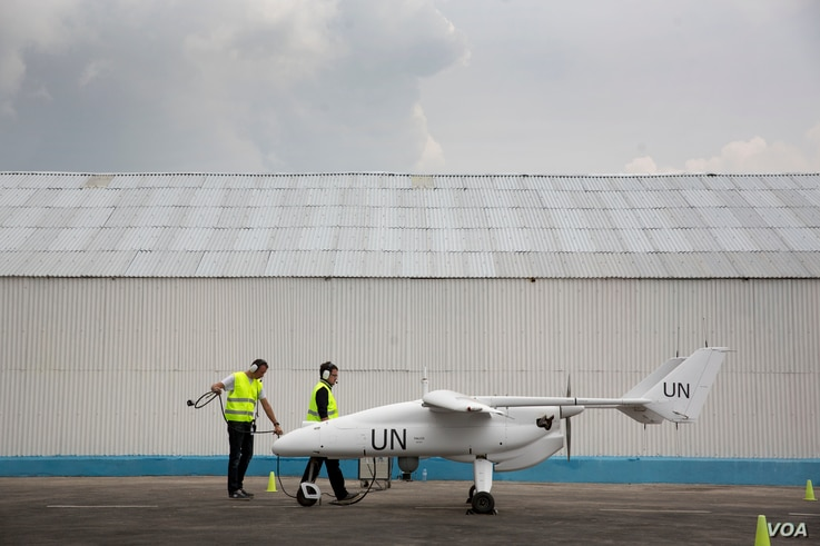 A technician team prepare the launch of UN drone during official ceremony with Herve Ladsous, Goma the 3rd of December 2013.   © MONUSCO/Sylvain Liechti