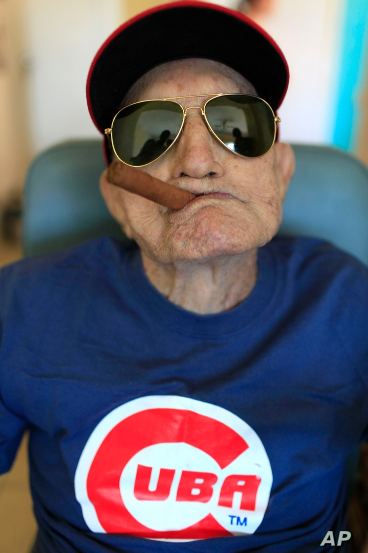 Conrado Marrero, the world's oldest living former major league baseball player, poses for a photo during his 102nd birthday bash at his home in Havana, Cuba, April 25, 2013.