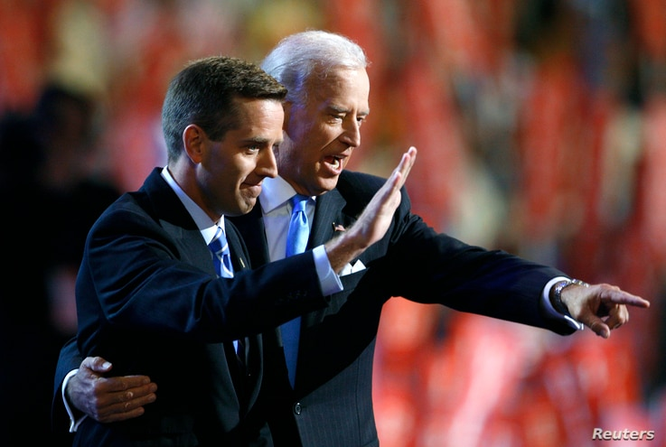 Attorney General Beau Biden (D-DE) (L) and Vice Presidential candidate Senator Joe Biden (D-DE) gesture on stage at the 2008 Democratic National Convention in Denver, Colorado August 27, 2008. U.S. Senator Barack Obama (D-IL) is expected to accept th...