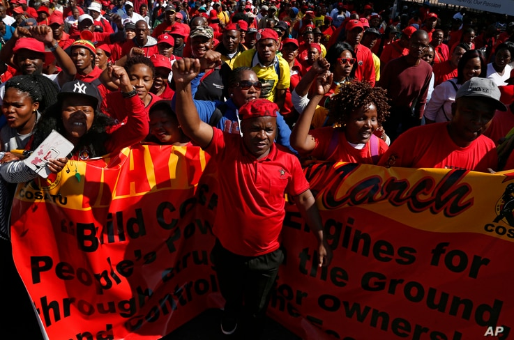 Workers take part in a May Day march to the Johannesburg Stock Exchange building on May 1, 2017.
