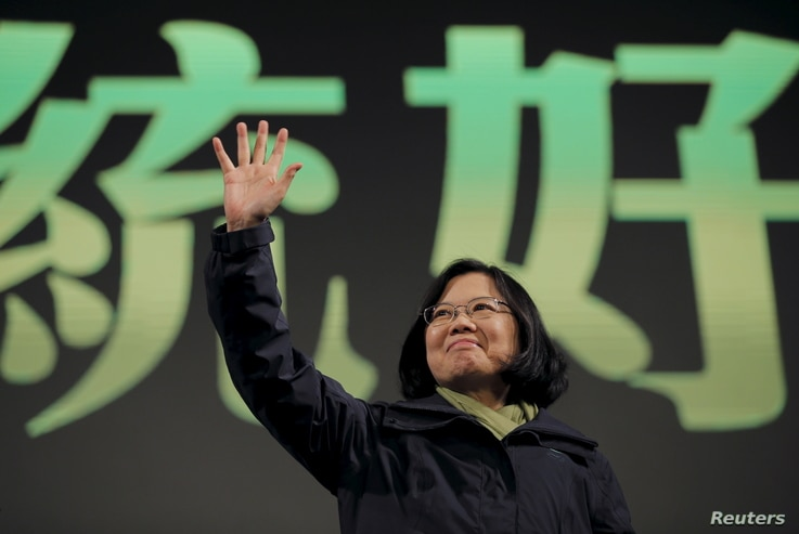 Democratic Progressive Party (DPP) Chairperson and presidential candidate Tsai Ing-wen waves to her supporters after her election victory at party headquarters in Taipei, Taiwan, Jan. 16, 2016.