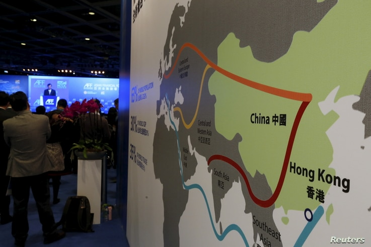 "FILE - A map illustrating China's silk road economic belt and the 21st century maritime silk road, or the so-called ""One Belt, One Road"" megaproject, is displayed at the Asian Financial Forum in Hong Kong, China Jan. 18, 2016."
