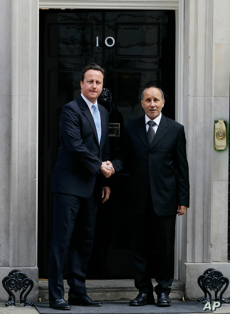 Britain's Prime Minister David Cameron (L) meets Mustapha Abdel Jalil, President of the Libyan Transitional Council, at Downing Street in London, May 2011.