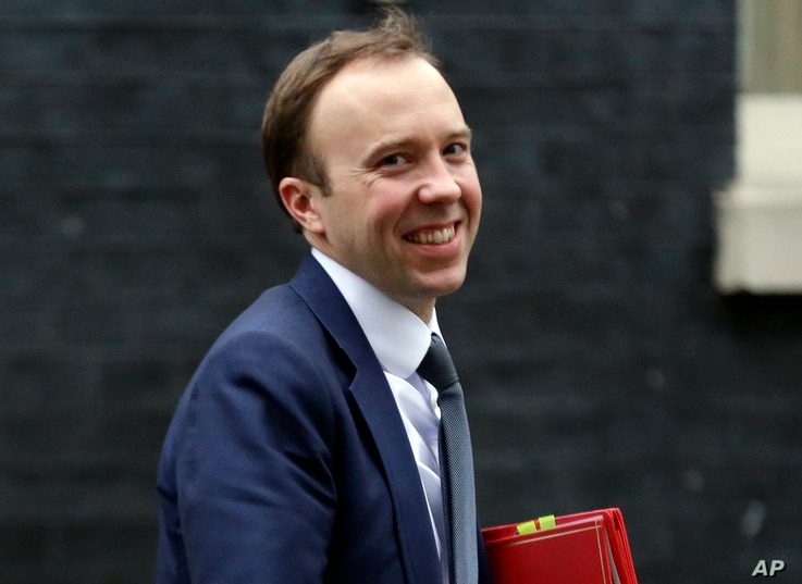 FILE - In this Jan. 9, 2018 file photo, Secretary of State for Digital, Culture, Media and Sport Matt Hancock smiles after leaving a Cabinet meeting in London.