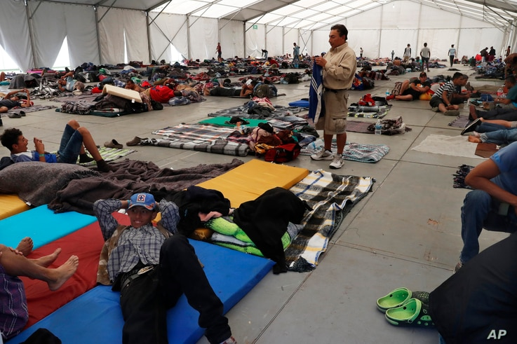 Central American migrants settle in a shelter at the Jesus Martinez stadium in Mexico City, in Mexico City, Jan. 28, 2019.