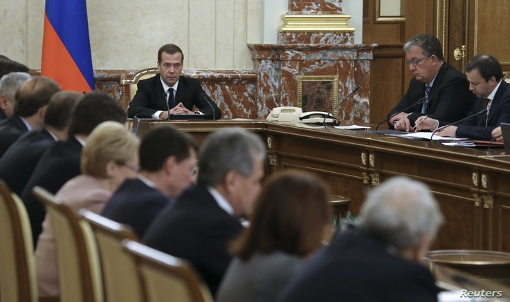 Russian Prime Minister Dmitry Medvedev, center rear, at a government meeting in Moscow, Russia, Nov. 26, 2015. Medvedev ordered measures drawn up that would include freezing some joint investment projects with Turkey.