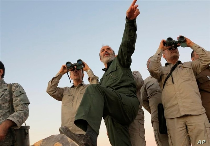 FILE -  A photo by the government-controlled Syrian Central Military Media, shows Iran's Army Chief of Staff Maj. Gen. Mohammad Bagheri, left, and other senior officers on the front line in the northern province of Aleppo, Syria, Oct. 20, 2017.