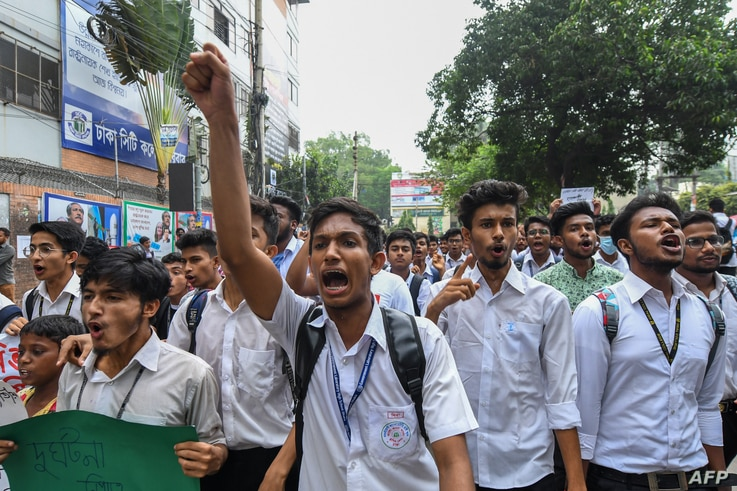 Bangladeshi students march along a street during a student protest in Dhaka, Aug. 4, 2018, following the deaths of two college students in a road accident.