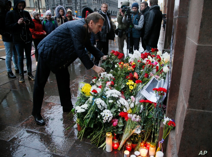 Sergei Naryshkin, speaker of the State Duma, lower parliament chamber, lays flowers in front of the French consulate in St.Petersburg, Russia,for the victims of the Paris attacks on Friday, Nov. 14, 2015.