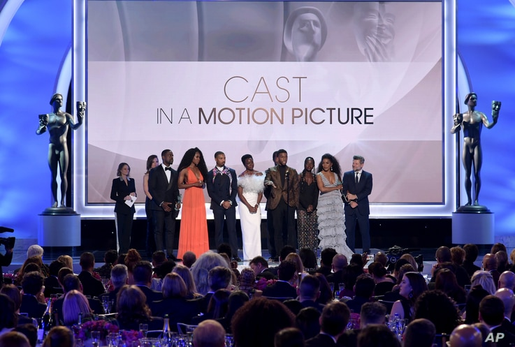 """The cast of """"Black Panther,"""" accept the award for outstanding performance by a cast in a motion picture at the 25th annual Screen Actors Guild Awards at the Shrine Auditorium & Expo Hall on Sunday, Jan. 27, 2019, in Los Angeles."""