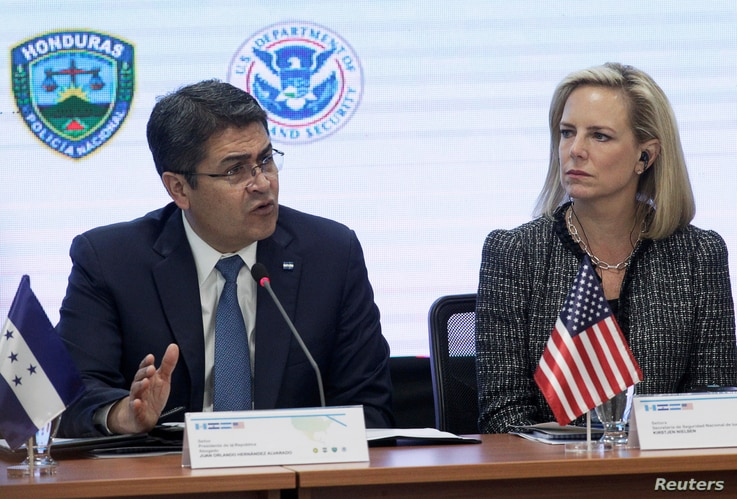 Honduran President Juan Orlando Hernandez speaks beside U.S. Secretary of Homeland Security Kirstjen Nielsen during a multilateral meeting at the Honduran Ministry of Security in Tegucigalpa, Honduras, March 27, 2019.