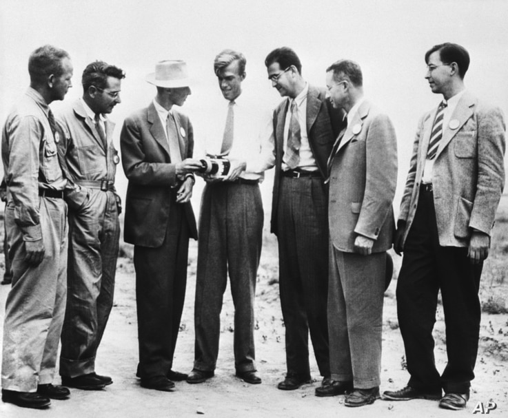 Seven atom bomb scientists look over a roentgenometer at the site of the test atom bomb explosion, Sept. 13, 1945. (From left) Dr. Kenneth T. Bainbridge, Harvard; Dr. Joseph G. Hoffmann, University of Buffalo; Dr. J. Robert Oppenheimer, California; ...