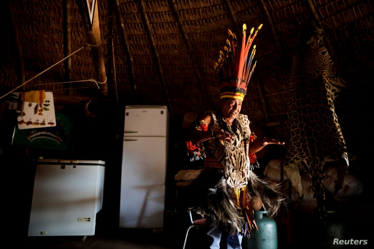 Pareci Indian Chief Narciso Kazoizax stands inside his house in Indian reservation, near Campo Novo do Parecis, Brazil, April 25, 2018.