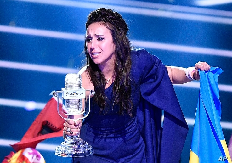 "Ukraine's Jamala celebrates with the trophy after winning the Eurovision song contest final with ""1944"" in Stockholm, Sweden, May 15, 2016."