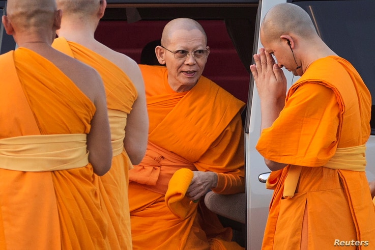 FILE - Abbot Phra Dhammachayo, center, arrives for a ceremony at the Dhammakaya Temple in Pathum Thani province, north of Bangkok, on Makha Bucha Day, March 4, 2015.