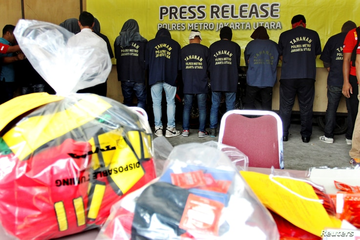 Some of the more than 140 men detained after a raid on what authorities described as a gay prostitution ring being run out of an entertainment venue are shown to the media at a police station in Jakarta, Indonesia, May 22, 2017.