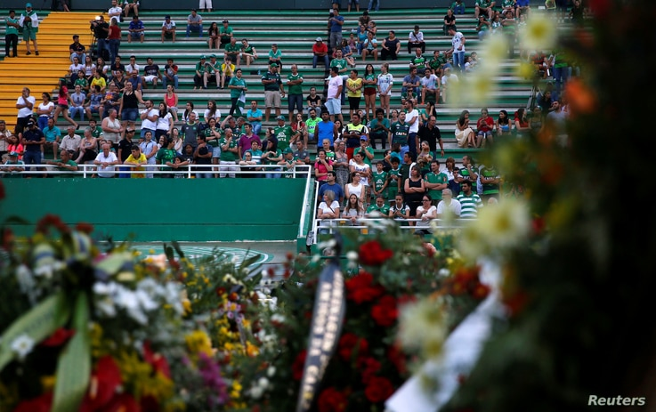 Fans of Brazil's Chapecoense soccer team wait before a ceremony mourning the victims after the plane carrying the team crashed in Colombia, at Arena Conda stadium in Chapeco, Brazil, Dec. 2, 2016.