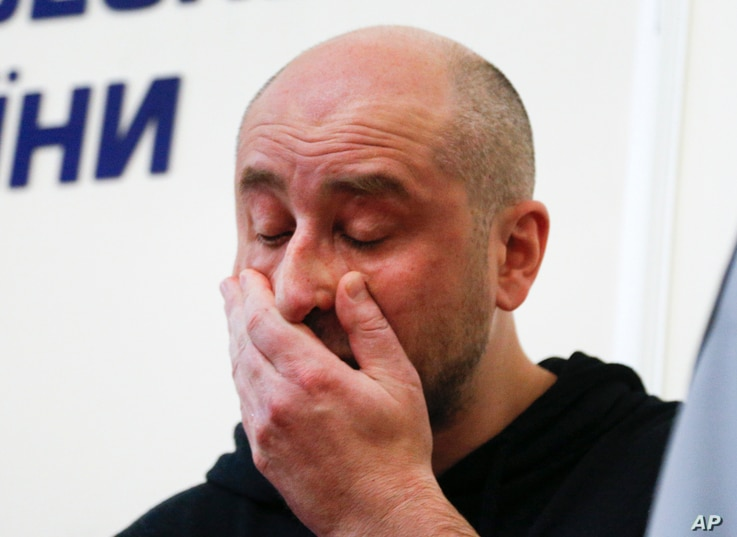 Russian journalist Arkady Babchenko reacts during a news conference at the Ukrainian Security Service on May 30, 2018.