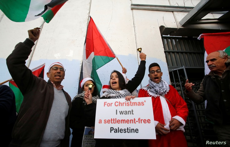 Palestinians take part in a protest at an Israeli checkpoint, in Bethlehem, in the Israeli-occupied West Bank, Dec. 23, 2018.