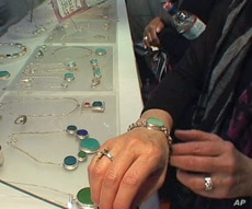 Amy Faust creates jewelry made from beach glass, recycled bottles, chipped dinner plates and pottery shards.