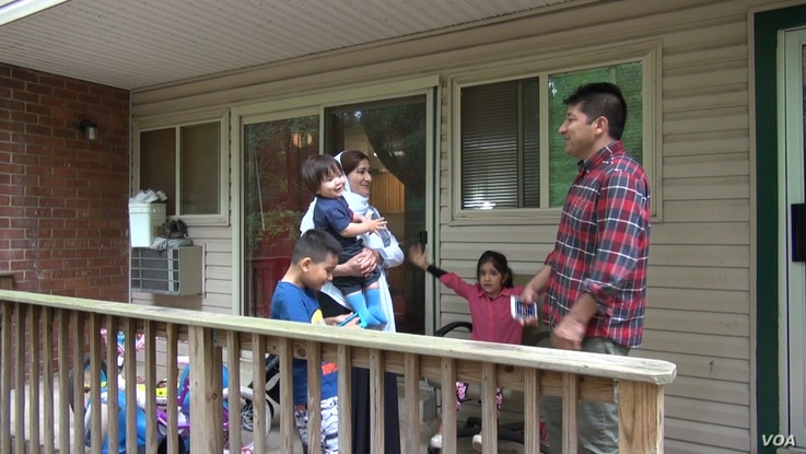 Dowlati with his family at their apartment in Riverdale, MD. Two of the children came over from Afghanistan. The third was born here. (J. Soh/VOA)