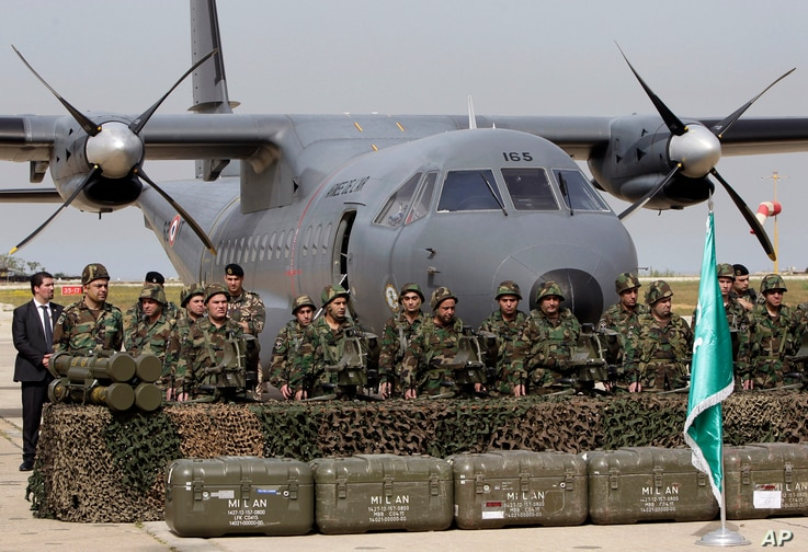 Lebanese army soldiers stand in front of French weapons at the Rafik Hariri International Airport in Beirut, Lebanon, April 20, 2015. The weapons were paid for by Saudi Arabia.