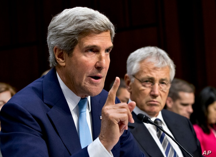 U.S. Defense Secretary Chuck Hagel (R) listens as Secretary of State John Kerry testifies on Capitol Hill in Washington, Sept. 3, 2013, before the Senate Foreign Relations Committee hearing to advance President Barack Obama's request for congressiona...