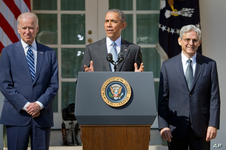 From left, Vice President Joe Biden listens as President Barack Obama announces the nomination of federal appeals court judge Merrick Garland for the Supreme Court, in the White House Rose Garden, Washington, March 16, 2016.