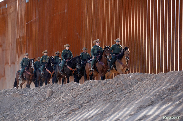 A mounted detachment of the U.S. Border Patrol along the wall during U.S. Department of Homeland Security Secretary Kirstjen Nielsen's visit to the El Centro Sector in Calexico, California, U.S., Oct. 26, 2018.