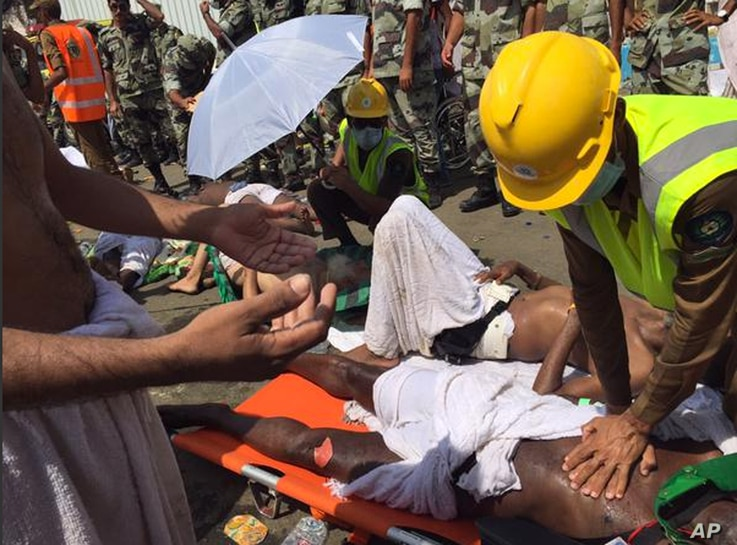 In this image posted on the official Twitter account of the directorate of the Saudi Civil Defense agency, a pilgrim is treated by a medic after a stampede that killed and injured pilgrims in the holy city of Mina during the annual hajj pilgrimage, S...