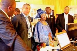 """South Africa's immigration chief, Jackie McKay (second from right) and the country's Minister of Home Affairs, Nkosazana Diamini-Zuma, are two key officials involved in """"regularizing"""" Zimbabwean migrants."""