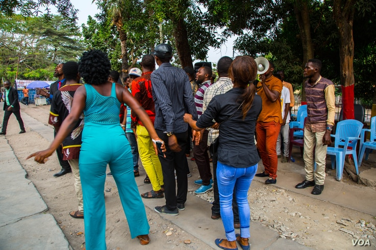 Singers and dancers gather at the ruling People's Party for Reconstruction and Democracy office grounds in Kinshasa, as they do nearly every day, to energize the public with lively music.