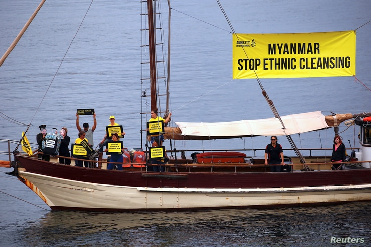 Protesters from Amnesty International display banners regarding the the Rohingya crisis in Myanmar as they sail a boat near the venue for the one-off summit of 10-member Association of Southeast Asian Nations (ASEAN) being held in Sydney, Australia, ...