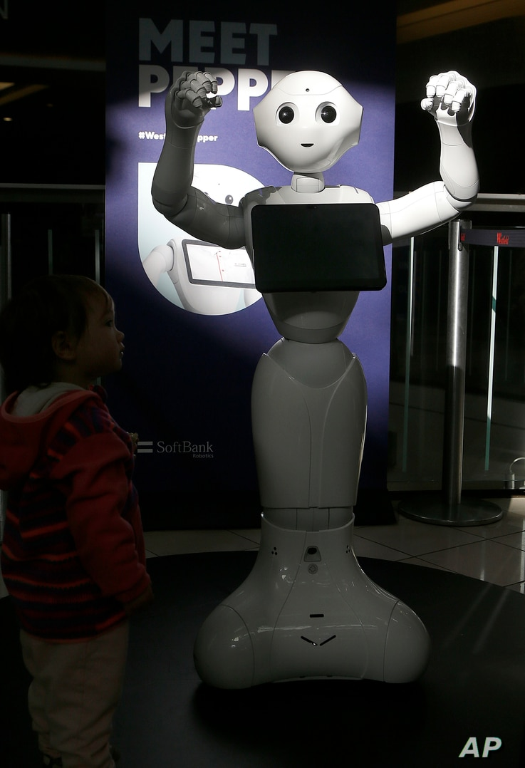 Kids are fascinated by 4-foot-tall Pepper, who can chirp, dance and pose for selfies, Dec. 22, 2016.