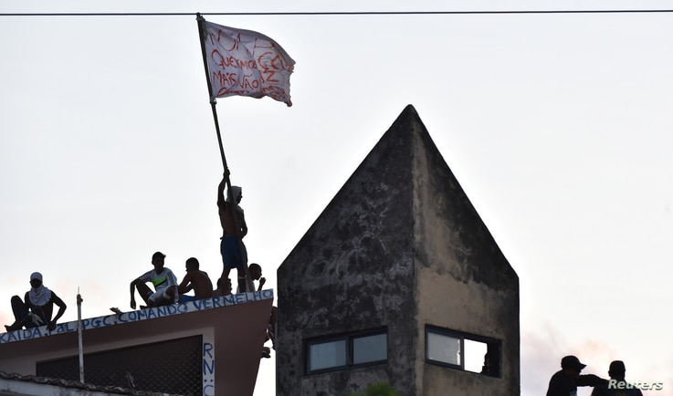 Inmates are pictured on roof after a new uprising broke out at Alcacuz prison in Natal, Rio Grande do Norte state, Brazil, Jan. 16, 2017.