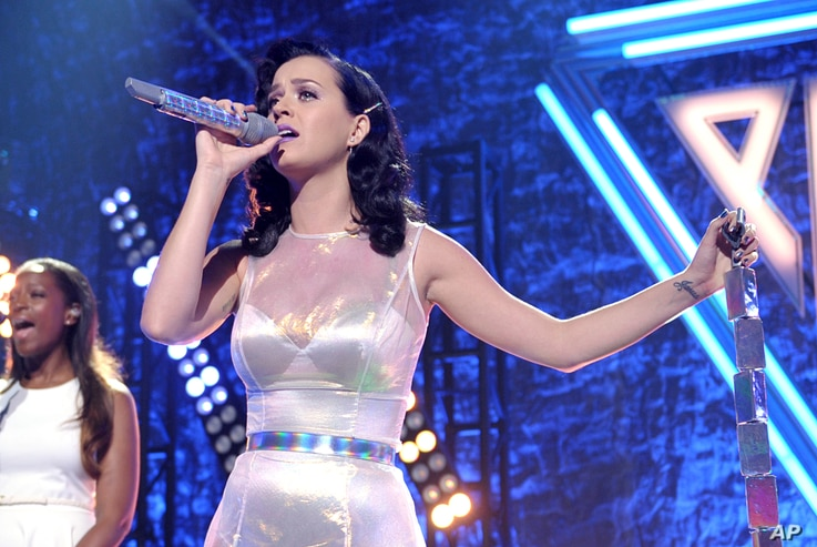 """Katy Perry performs at her iHeartRadio """"Prism"""" album release party at the new iHeartRadio Theatre on Oct. 22, 2013, in Burbank, Calif."""