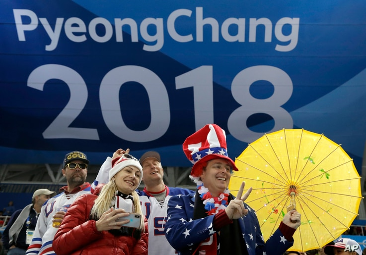 Fans cheer during the third period of the women's gold medal hockey game between the United States and Canada at the 2018 Winter Olympics in Gangneung, South Korea, Feb. 22, 2018.