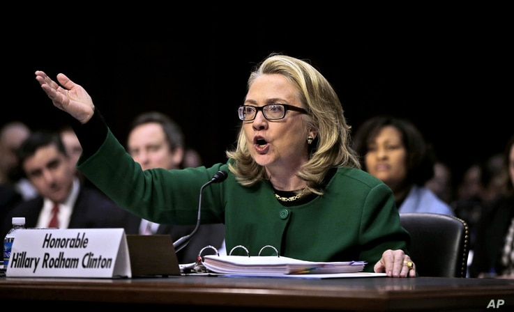 Secretary of State Hillary Clinton testifies on Capitol Hill in Washington, January 23, 2013, before the Senate Foreign Relations Committee hearing on the deadly September attack on the U.S. diplomatic mission in Benghazi, Libya, that killed Ambassad...