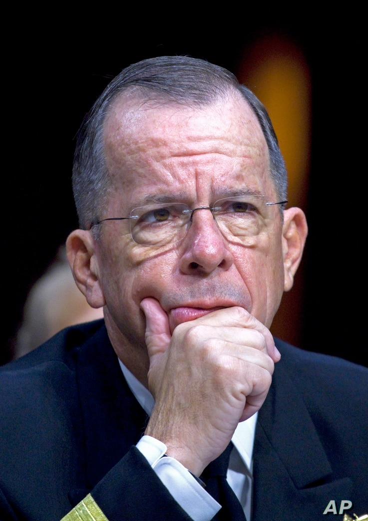 FILE - Then-Joint Chiefs Chairman Admiral Michael Mullen testifies on Capitol Hill in Washington, Sept. 22, 2011, before a Senate committee.