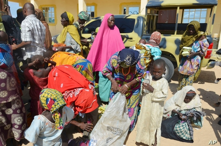 Women and children rescued by Nigerian soldiers from Boko Haram extremists in northeast Nigeria arrive at the military office in Maiduguri, Nigeria, July 30, 2015.