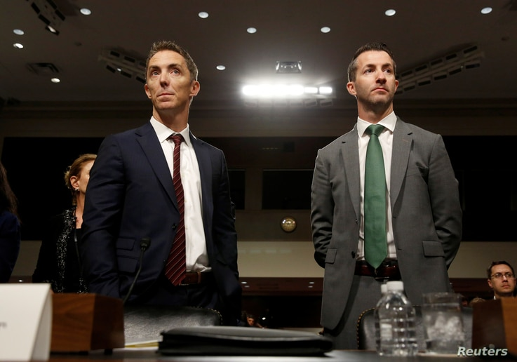 FILE - Keith Enright, chief privacy officer at Google, and Damien Kieran, global data protection officer and associate legal director at Twitter, stand before testifying before a Senate panel on Capitol Hill, in Washington, Sept. 26, 2018.