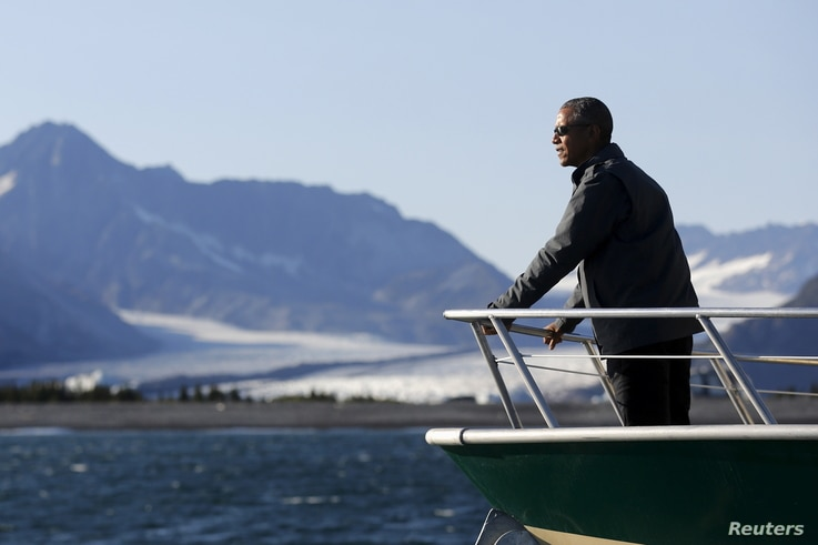 U.S. President Barack Obama views Bear Glacier on a boat tour of Kenai Fjords National Park in Seward, Alaska September 1, 2015. Obama on Tuesday proposed a faster timetable for buying a new heavy icebreaker for the U.S. Arctic, where quickly melting...