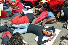 Masked sex workers lie down in protest in front of the Kenyan Supreme Court in Nairobi, March 6, 2012.