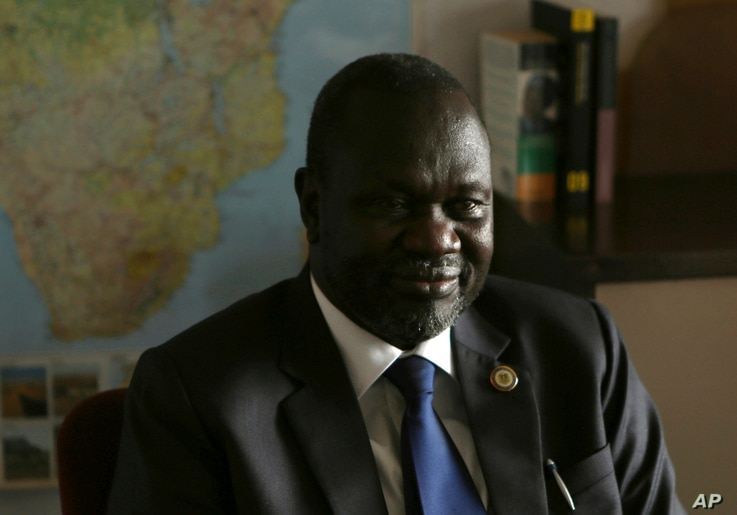 FILE - South Sudan rebel leader Riek Machar speaks in an interview with The Associated Press in Johannesburg, on Oct. 20, 2016.